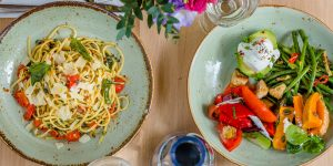 Tasty chilli, garlic & tomato linguine and a colourful summer salad selection
