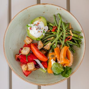 Summer salads with avocado, soft-boiled egg and chia