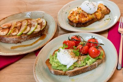 A selection of posh toast on grilled sourdough