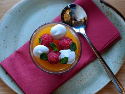Lemon posset with passion fruit jelly, raspberries and miniature merigues